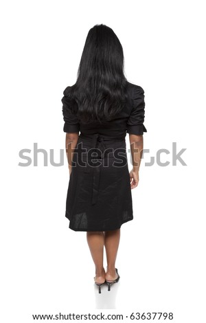 Isolated full length studio shot of the rear view of a Latina businesswoman. - stock photo