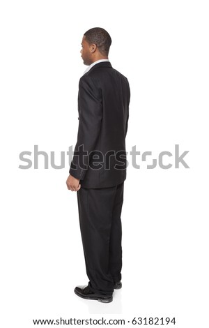 Isolated full length studio shot of the rear view of an African American businessman.