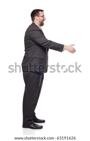 Isolated full length studio shot of the side view of a businessman reaching out to shake hands - stock photo