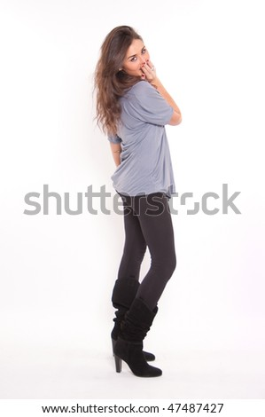Isolated full portrait of a cute young brunette covering her mouth in embarrassment - stock photo
