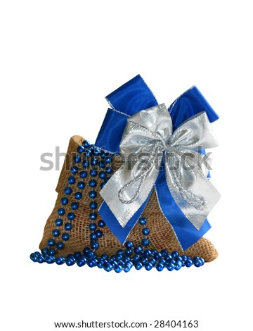 isolated gift bag with band and beads - stock photo
