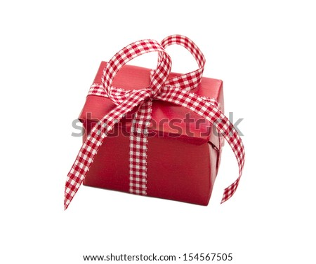 Isolated gift box wrapped in red paper for christmas or birthday with checked ribbon. - stock photo