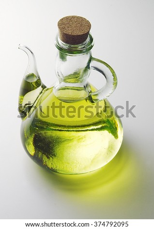 Isolated Glass cruet with oil on white plane
