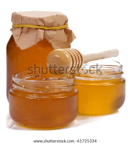 isolated glass pots with honey
