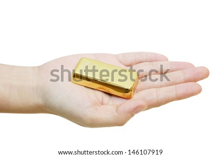 isolated gold bar on a hand - stock photo