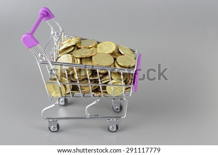 Isolated gold coins in the trolley - Business Concept - stock photo