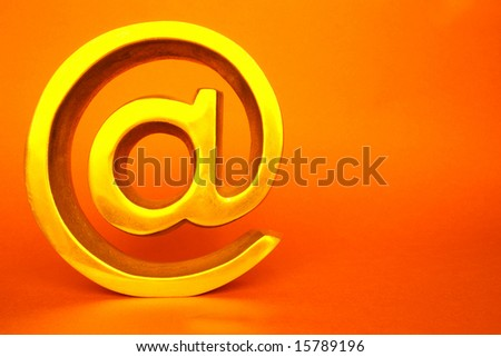 Isolated golden arroba in color back ground - stock photo
