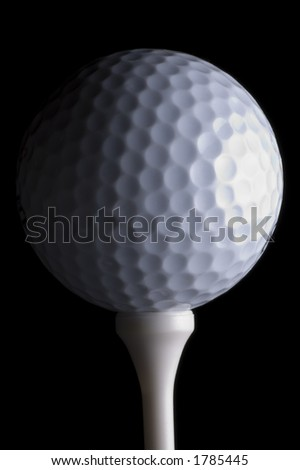 Isolated golf ball and tee close up