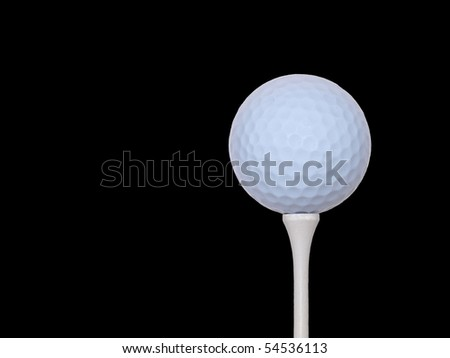 isolated golf ball and tee on black