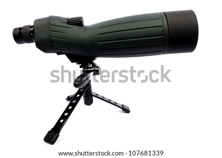 Isolated green and black spotting scope able to zoom in 60X. - stock photo