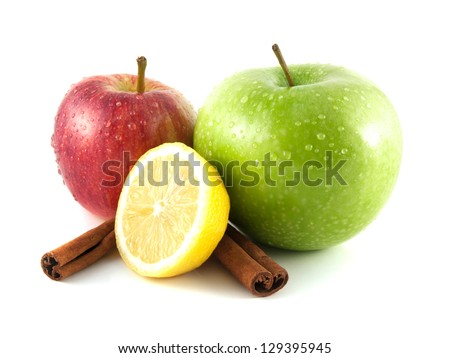Isolated green and red apples, lemon with cinnamon pods (white background). Fresh diet fruit (water drops). Healthy fruit with vitamins. - stock photo