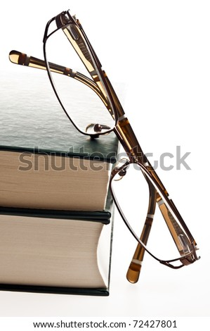 Isolated green books and eyeglasses