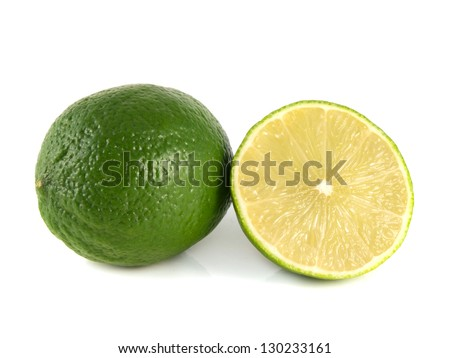 Isolated green lime with sliced half on a white background. Fresh diet fruit. Healthy fruit with vitamins.