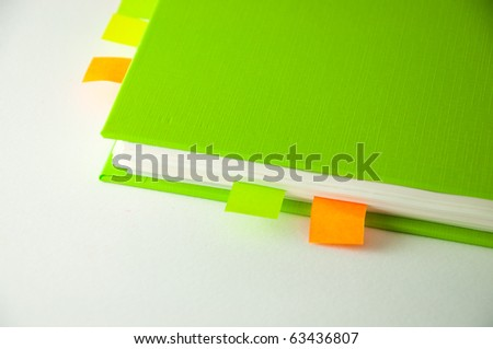 isolated green notebook on white.
