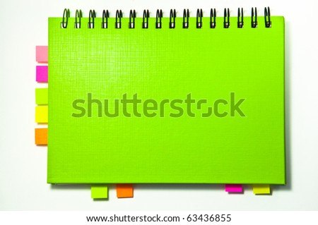 isolated green notebook on white. - stock photo