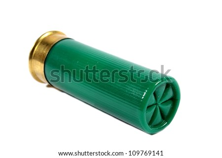 Isolated green shotgun shell used for hunting large animals or self defense. - stock photo