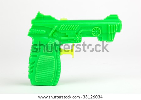 Isolated green toy water pistol. - stock photo