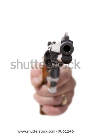 Isolated gun being aimed at the viewer (shallow depth of field)
