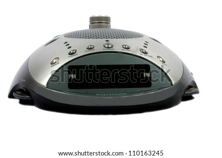 Isolated half circle silver digital alarm clock with radio - stock photo
