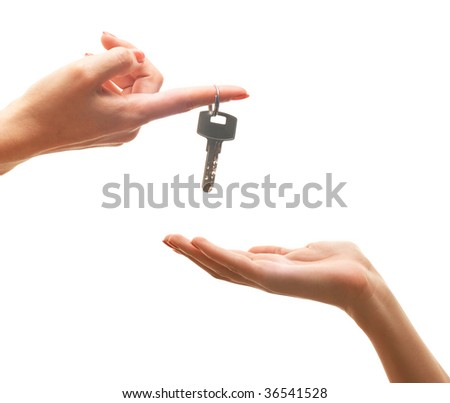 isolated hand gives a key