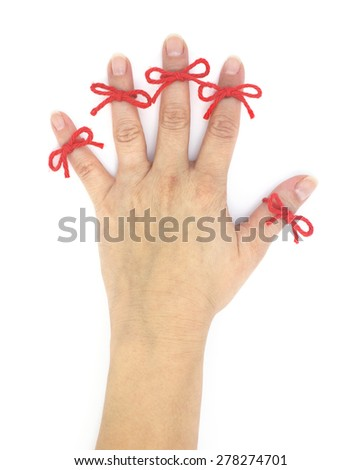 Isolated hand with five red string bows attached. - stock photo