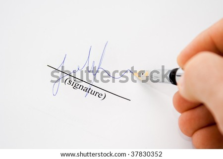 Isolated hand with fountain pen signing paper - stock photo