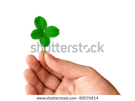 Isolated hand with green four leaf clover - stock photo