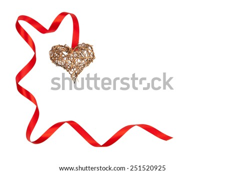 Isolated handmade wooden heart and curled red ribbon forming a romantic Valentine frame with copy space. - stock photo