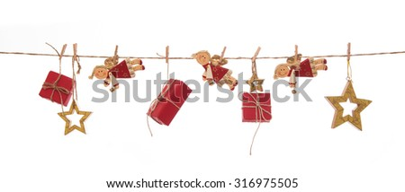 Isolated hanging red christmas gifts, angels and golden stars on white background for decoration. - stock photo
