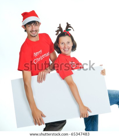Isolated happy christmas couple with banner