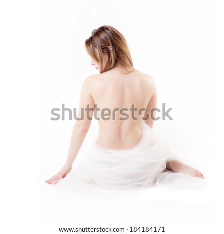 Isolated happy woman in towel on white background