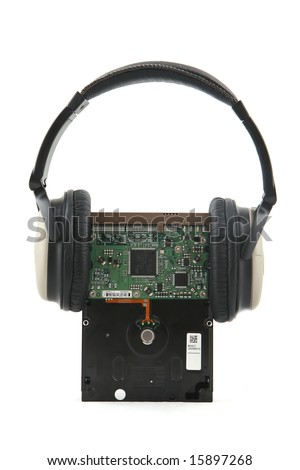 Isolated hard-disk with headphone shot over white background. - stock photo