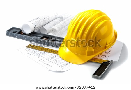 isolated hard hat with blueprints and rulers on white