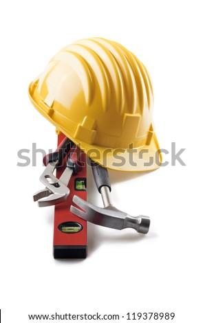 isolated hard hat with tools on white - stock photo