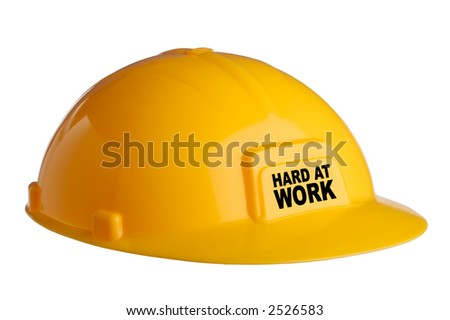 "isolated hardhat with the text ""Hard at work"" - stock photo"