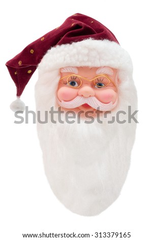 Isolated head of a Santa Claus Puppet - stock photo