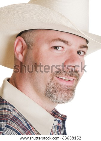 Isolated headshot of a man in a cowboy hat. - stock photo