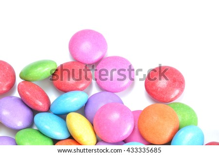 Isolated heap of colored candies on white background  - stock photo