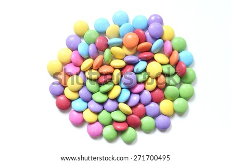 Isolated heap of colored smarties on white background - stock photo