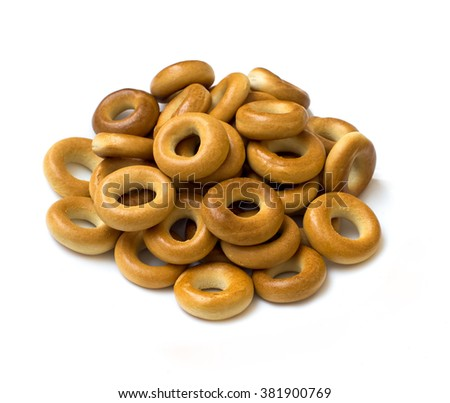 Isolated heap of small rounds of dry bagels. - stock photo