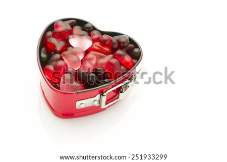 isolated heart shaped mold with heart jelly beans - stock photo