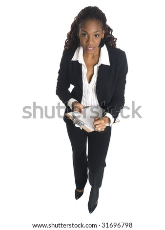 Isolated high angle studio shot of a businesswoman writing on a clipboard. - stock photo