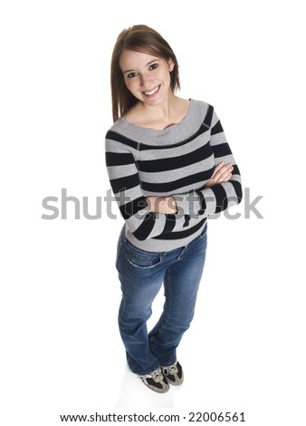 Isolated high angle studio shot of a casually dressed young adult female college student smiling at the camera. - stock photo