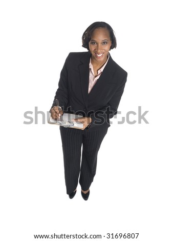 Isolated high angle studio shot of a happy businesswoman writing on a clipboard.