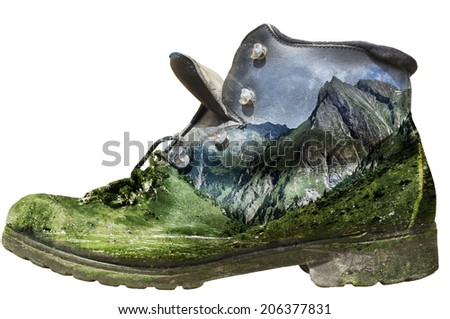 Isolated historic hiking boot with alp panorama overlay - stock photo