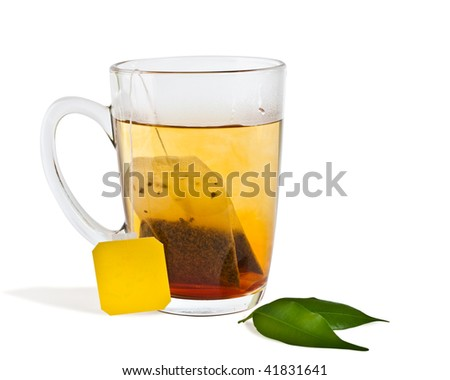 isolated hot tea in transparent glass cup with label - stock photo