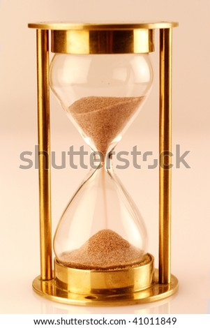 Isolated hourglass - stock photo
