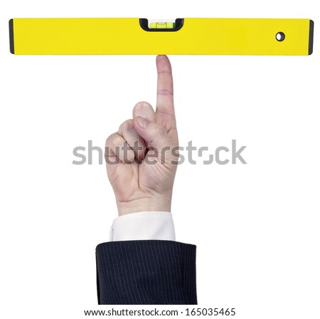 Isolated human finger hold a perfect large yellow water level - stock photo