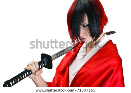 Isolated image. Brunette with short dark and red hair with a stern look holding by two hands a sword katana