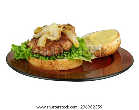isolated image of a burger sandwich with lettuce, tomato, onion, cheese, and mustard on a plate ready to be eaten - stock photo
